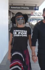 Paris Hilton Steps out without a bra as she catches a flight at LAX airport with her boyfriend in Los Angeles