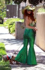 Phoebe Price Poses for pictures with her dog wearing a mermaid outfit in Los Angeles