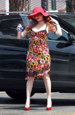 Phoebe Price Sanitizes outside the grocery store