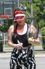 Phoebe Price Seen at the tennis courts wearing a mask in Los Angeles