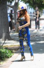 Phoebe Price Takes her dog for a walk in Hollywood