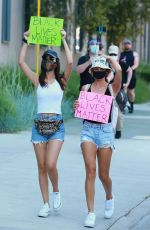 Victoria Justice & Madison Reed join a protest in Los Angeles