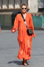 Vogue Williams Exits Heart Radio in orange dress in London
