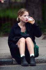 Alice Eve Enjoying drinks on the pavement with a friend in London
