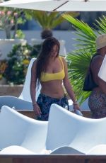 Anastasia Karanikolaou Cools off at the hotel pool with friends during her vacation in Cabo San Lucas