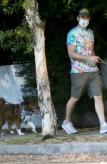 Aubrey Plaza Fools around with the shutterbugs as she and Jeff Baena walk their dogs in Los Angeles