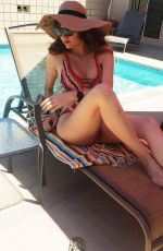 Blanca Blanco Hangs out by her pool wearing a colored one-piece in Los Angeles