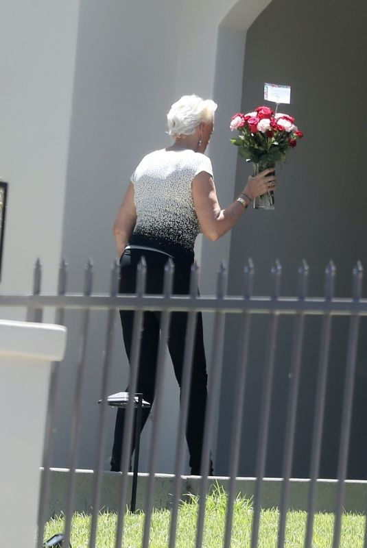 Brigitte Nielsen Recieves a bouquette of flowers on her 57th birthday