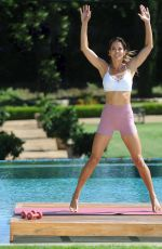 Brooke Burke Taping segments for her Brooke Burke Body app in the backyard of her house - Malibu