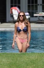 Brooke Shields In Stars and stripes bikini at her home pool in the Hamptons