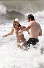 Brooks Nader and her husband William are photographed in the beach in the Hamptons New York