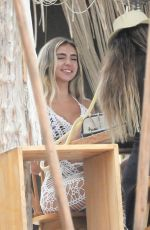 Bruna Rangel Lima relaxin at the food table with friends after a full weekend of parties in Tulum