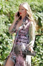 Caprice Takes a phone call as she heads to a meeting in West London
