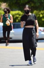 Charli XCX Flashes her midriff during a visit to the grocery store in Los Angeles