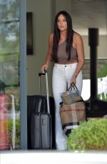 Charlotte Crosby and Sophie Kasaei struggle with their luggage as they leave for Ibiza