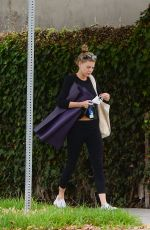 Charlotte McKinney Picks up sunflowers and eggs at a farmers market following a yoga class in Los Angeles