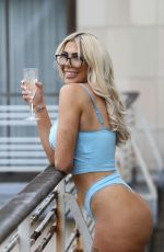Chloe Ferry Chilling on the balcony enjoying a glass of fizz in a sexy skimpy blue matching Angel Lingerie set