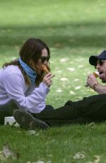 Chris Evans & Lily James Seen eating ice cream on a date in the park in London