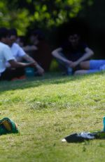 Claire Foy Enjoying ice cream in the park in London