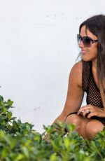 Claudia Romani Feeds homeless cats on her way to the beach in Miami