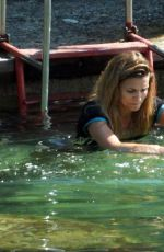 Cristina Chiabotto Taking a bath in the sea early in the morning, then having breakfast with a pizza in Portofino, Italy