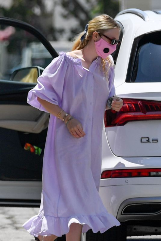 Dakota Fanning Arrives at a spa wearing a pink face mask in Los Angeles