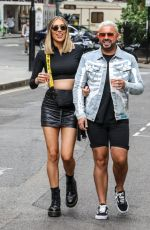 Demi Sims and Dean Rowland enjoying drinks in Soho Square in London