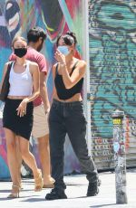 Dua Lipa Waits for her takeout with a friend in NYC