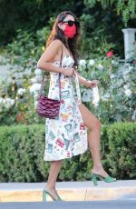 Eiza Gonzalez Stuns in a colorful festive dress with green heels while arriving at San Vicente Bungalows in Los Angeles