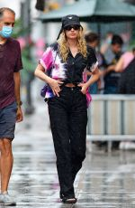 Elsa Hosk And Tom Daly get caught in a brief sun shower in New York