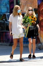Elsa Hosk Buying a bouquet of sunflowers in NYC