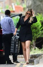 Emily Atack Showing off her legs in a mini shirt dress while pictured out in London