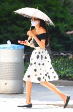 Famke Janssen Turns heads as she shades herself with a parasol during a solo stroll in New York