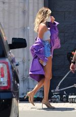 Hailey Bieber Shows off her slim pins in Daisy Dukes as she arrives to a music video set in Los Angeles