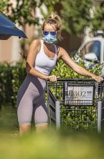 Hayley Roberts Putting it all on display in skin tight workout pants as she picked up groceries in Calabasas