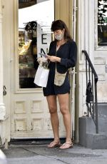 Helena Christensen Hugs a mystery male companion after getting take-out in New York City