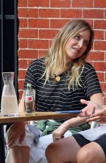 Jason Biggs and wife Jenny Mollen are pictured at a cafe in New York City