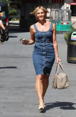 Jenni Falconer Shows off her incredible physique in a denim dress as she exits the Smooth Radio Studios in London