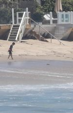 Jennifer Garner Shows off her toned arms and shoulders while running on the beach in Malibu