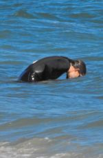 Jennifer Garner Slips into a wet suit for a swim with her son Samuel in Malibu