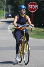Jennifer Lopez Hops on her cute yellow bike for a ride in The Hamptons