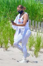Jennifer Lopez Meditates on the beach in the Hamptons