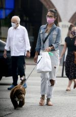 Jordana Brewster Walks her puppy to pick up food at Farmshop in Brentwood