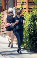 Kate Mara Picks up a couple coffee drinks in a black ensemble in Los Feliz