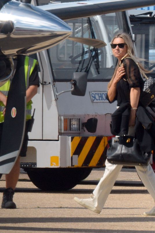 Kate Moss Boarding a private jet at Luton London airport