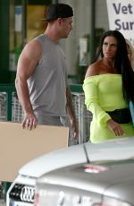 Katie Price Looked in high spirits as she enjoyed a day out with her new boyfriend Carl Woods in Surrey
