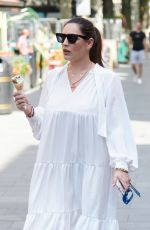 Kelly Brook Grabbing an ice cream and arriving at the Global Radio Studios in London