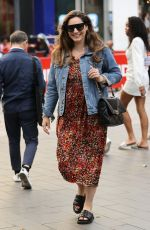 Kelly Brook Looks great in a floral dress as she exirs Heart radio in London