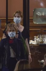 Laetizia Casta and Isabelle Huppert are spotted leaving the Bolognese restaurant in Rome