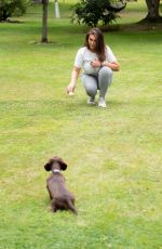 Lauren Goodger Playing with a Dachshund in a park in Essex